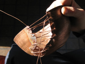 Sewing formed copper bowl with copper wire in copper enamel process, enameling