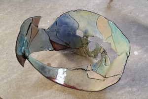 The first layer of color application in the enameling process after firing.