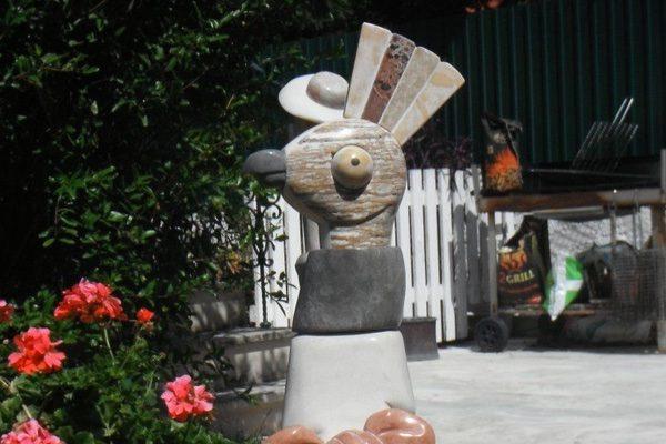 Stone sculpture of a bird's head