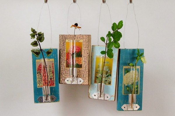Seed packets on old wooden boards make floral art by Amy Duncan