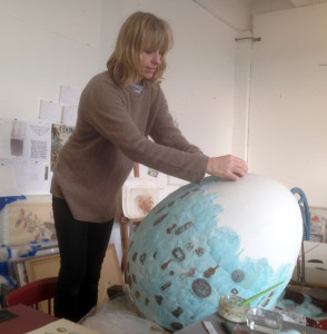 Rebecca Jewell working on a 3-D egg covered in Feather printing