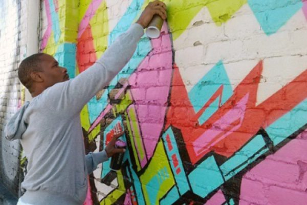 Hamilton Glass working on one of his murals