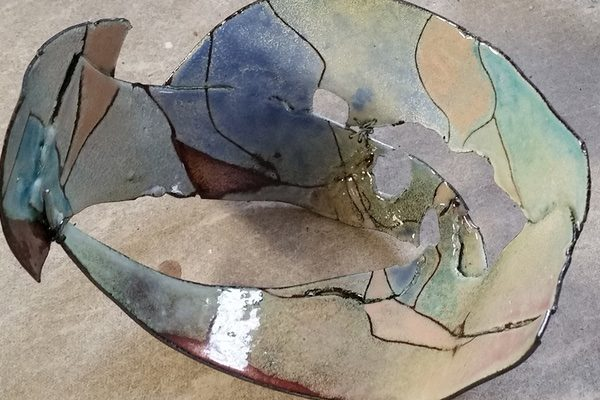 The first layer of color application after firing in one of Judy Stone's work