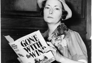 Gone With the Wind author Margaret Mitchell posing with her novel.