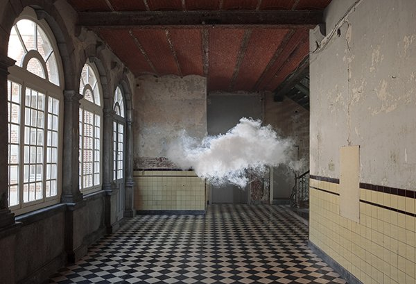 A photograph of an empty ornate hallway with a cloud in the middle