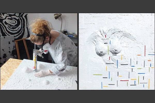 Agnieszka Gzyl at work on one of her paintings with plaster