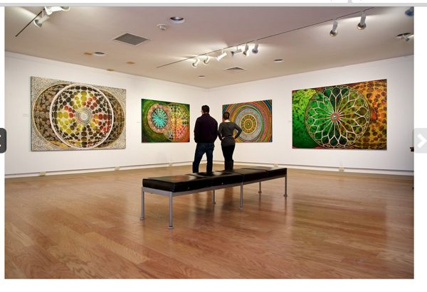 Colorful abstract oil paintings at a gallery exhibition
