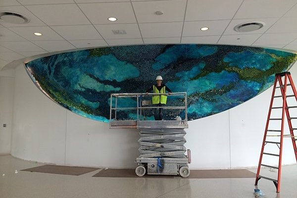 Amy Genser at work on one of her large-scale installations