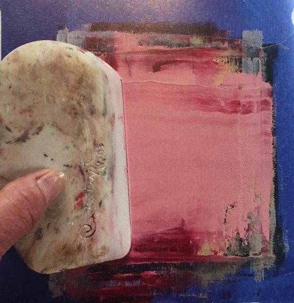A photograph of a cold wax medium being worked with to create a painting