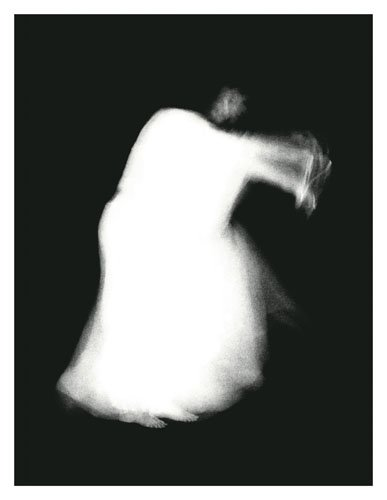 A black and white photograph of a ghostly white figure