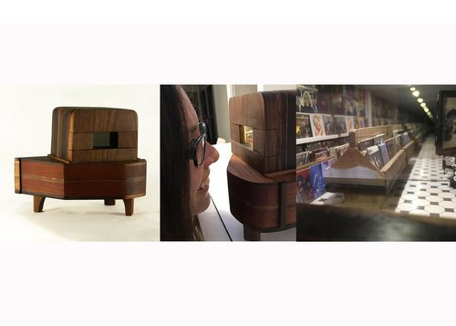 The exterior and interior of a piano-shaped sculpture with a miniature record store model inside