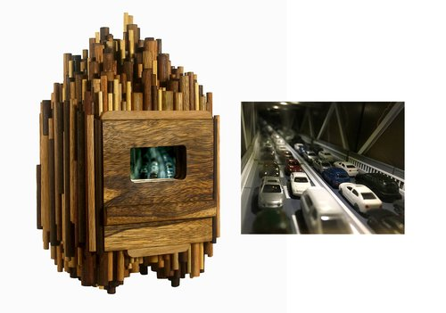 The exterior and interior of a sculpture with a miniature model freeway inside