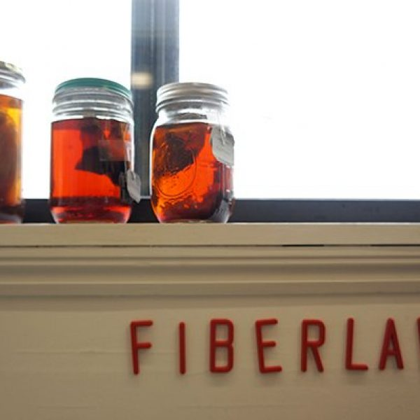 A windowsill with sticker letters spelling Fiberlab under the sill