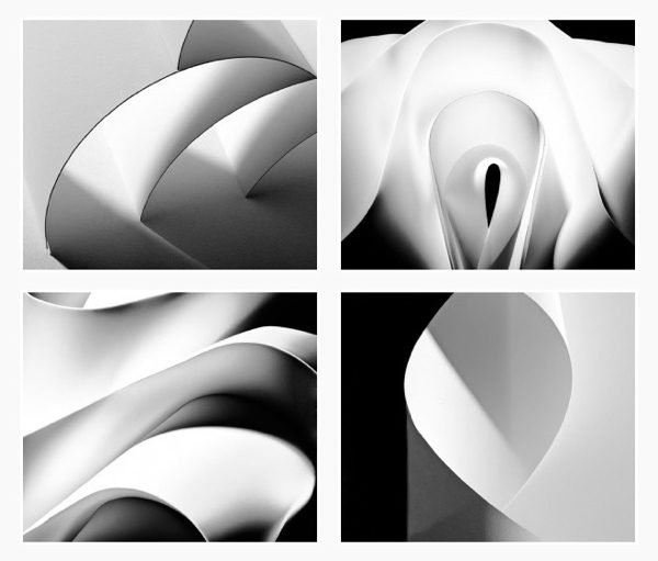 A series of black and white close up photographs of pieces of paper