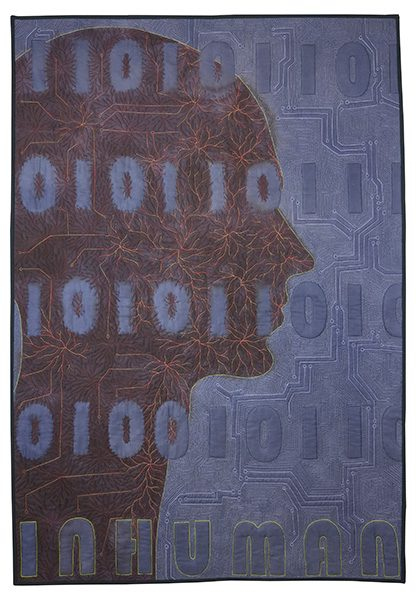 A quilt piece of a women's silhouette with binary code covering the piece