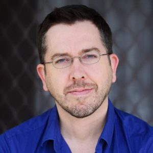 Headshot of writer Stuart Kells