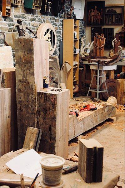Wooden sculptures and works in progress in the corner of an artist's studio