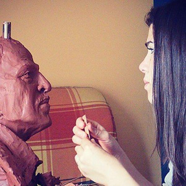 Sculptor Susan Clinard works on a bust