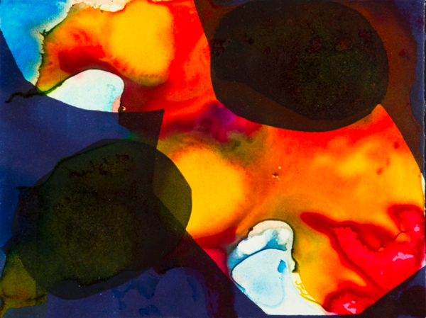 A print of bright orange and yellow splatters bordered by dark blue and black