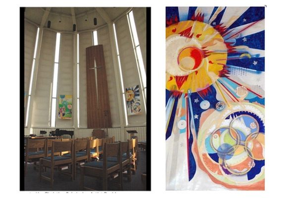 Colorful abstract paintings representing the six days of creation hang in a church