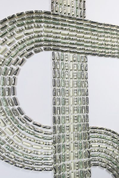 A dollar sign composed of rolled up dollar bills