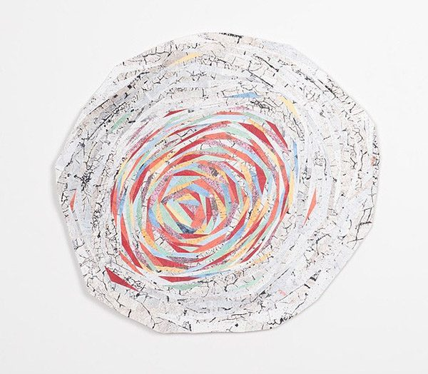 Cut photographs and paintings turned into a spiral-shaped collage