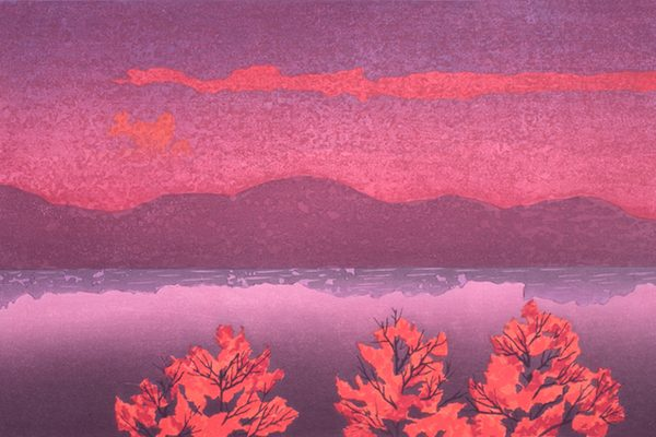 A woodcut of a lake, with trees in the foreground and mountains in the background, at sunset