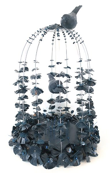 An installation of a bird in a cage