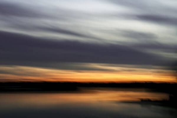 Abstracted photograph of a harbor at sunset