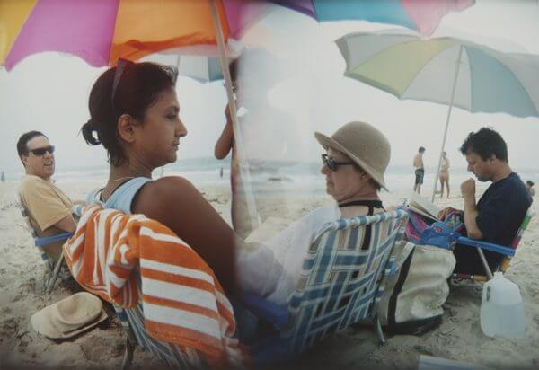 Two photographs melded together of a family at a beach