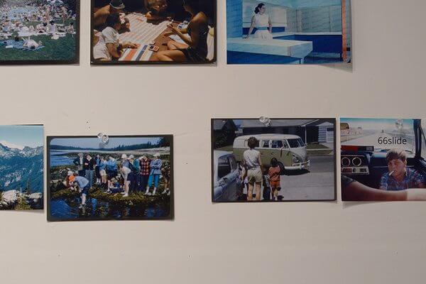 Photographs tacked onto the wall of a photographer's studio