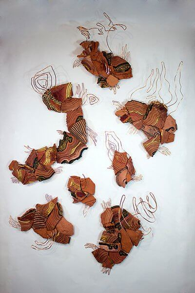 Shards of destroyed pottery installed with copper wire