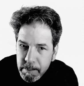 Black and white headshot of artist Greg Skol