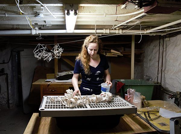 Hanna Vogel pulp-pouring in her basement