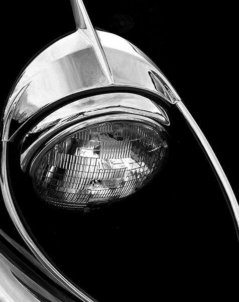 David Quinn, black and white photograph of a car headlight.