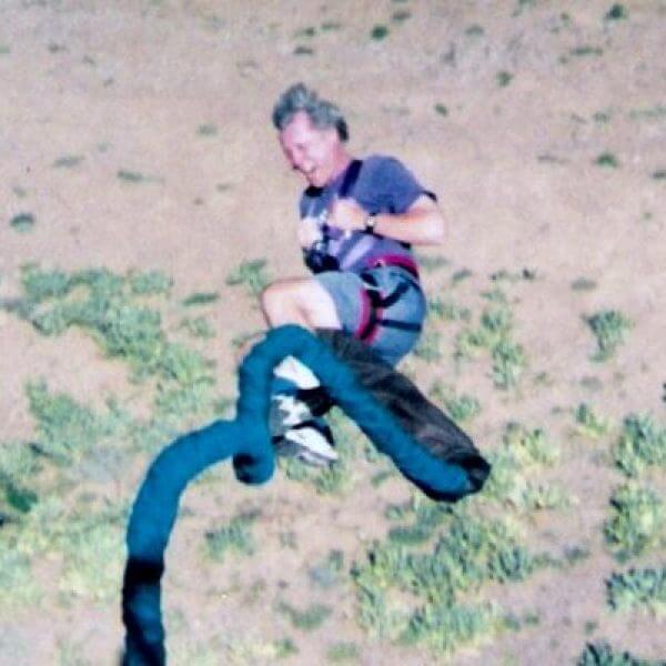 A man mid-bungee jump on his way down