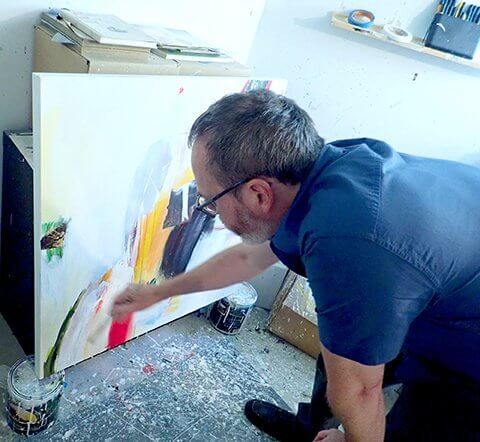 David Criner painting in his studio