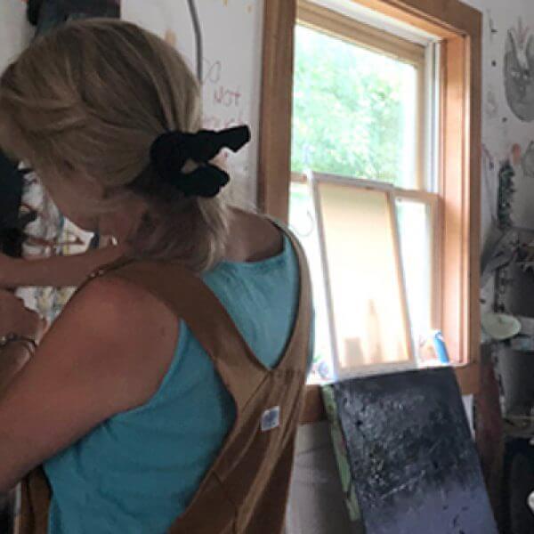 Painter Dorothea Osborn works on a canvas painting