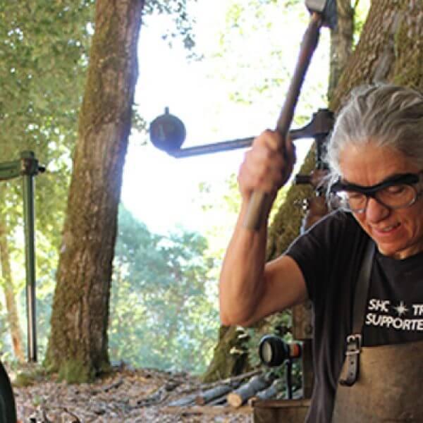 Monica Coyne at work at her anvil