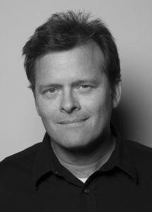 Black and white headshot of writer David Blair