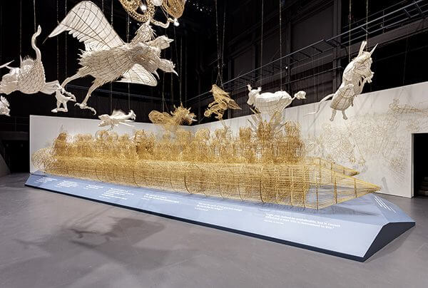 a massive bamboo vessel bursting with human-animal hybrid