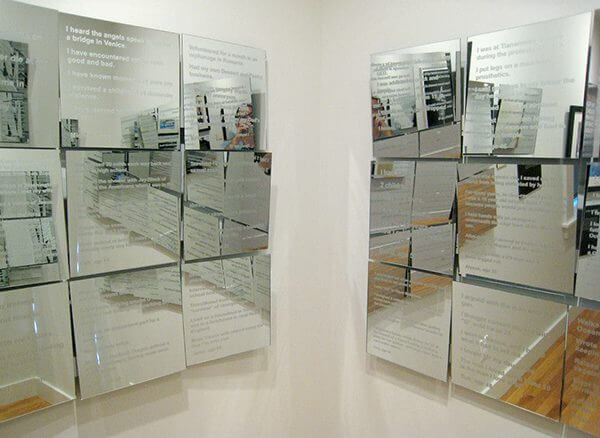 Square panels of mirrors with text etched into them