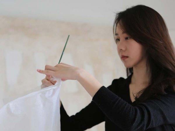 Bo Kyung Kim working in her studio