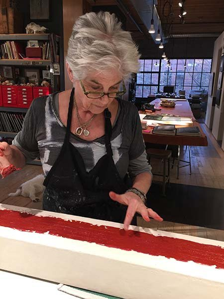 Catherine Eaton Skinner working in her renovated Seattle studio