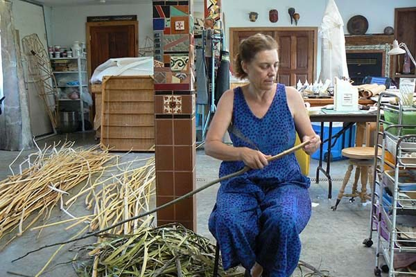 Jo Stealey working with twigs and branches in her studio
