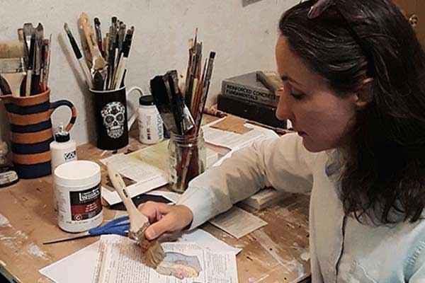 Maya Kuvaja painting in her studio