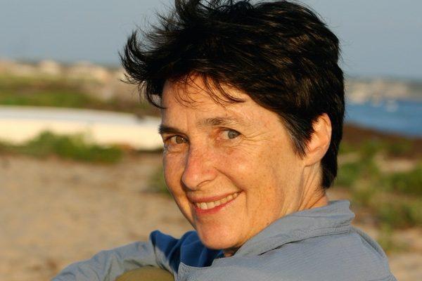 Poet Laura Foley on the beach