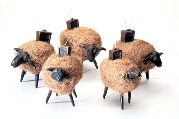 Sculpture of sheep with television sets on top of them