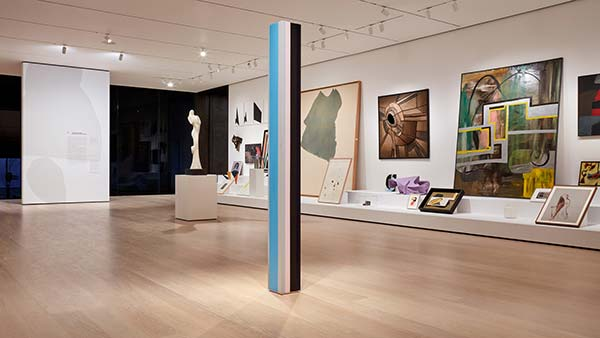 Installation view of sculptures, photography, and paintings at an exhibit in New York
