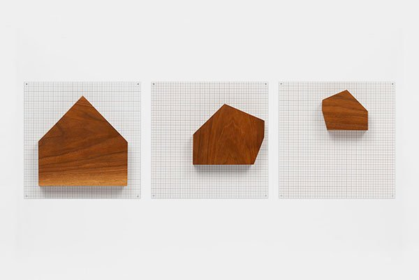 three house-shaped wooden blocks of varying sizes on silkscreen